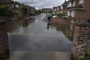Burst water main at London Road flooding nearby houses in Charnwood Close. EMN-190608-141509009