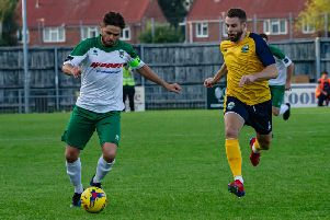 Skipper Harvey Whyte on the ball in the friendly at Gosport / Picture by Tommy McMillan