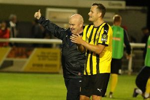 Paul Holleran and Joe Clarke salute the home faithful after the win over Brackley. Picture: Tim Nunan
