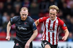 Derry City midfielder Greg Sloggett tussles with Dundalk's Chris Shields. Picture by Oliver McVeigh/Sportsfile
