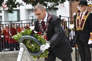 Graeme Stenhouse, Governor of the General Committee of the Apprentice Boys of Derry, places a wreath at the War Memorial on Saturday morning ahead of the main parade. DER3319-112KM