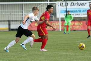 Banbury United's Anderson Cayola Villarroel comes away with the ball from Royston Town's Joseph Newton