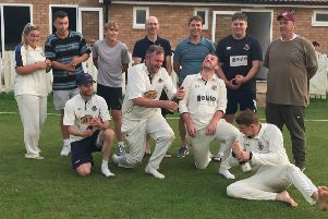 Orton Park celebrate their Hunts Division One title win.
