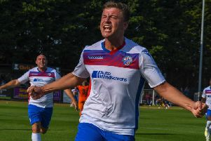 Alex Collard shows his delight after he headed home the stoppage-time winner for AFC Rushden & Diamonds on Monday. Pictures courtesy of HawkinsImages