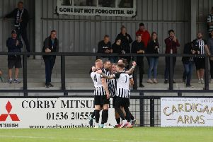 Steve Diggin takes the congratulations after he scored the first of his two penalties in Corby Town's 2-0 victory over AFC Dunstable at Steel Park. Picture by Alison Bagley