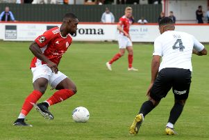 Brackley Town's Lee Ndlovu takes on AFC Telford United's Ellis Deeney. Photo: Jake McNulty
