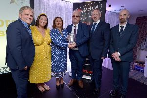 Richard Moore, Children In Crossfire, receives the Lifetime Achievement Award, from Mayor of Derry City and Strabane Colr. Michaela Boyle, at the Derry Journal People of the Year Awards held recently in the Waterfoot Hotel. Included in the photograph are Adrian Logan, compere, Niamh Moore, Paul McLean, managing director, BetMcLean, principle sponsor, and Brendan McDaid, Editor, Derry Journal. DER3619GS ' 081