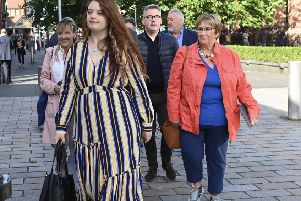 Emma De Souza outside court in Belfast with nationalist politicians. She is taking a case claiming that she is not a UK citizen, despite being born in the UK, saying this is superseded by the Belfast Agreement