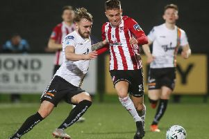 Derry City's Jack Malone battles with Bohemians Luke Wade Slater.