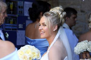 Our Charley. The beaming bride looked happy and relaxed as she entered the church