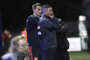 Nicky Eaden and Luke Graham watch on from the sidelines during what proved to be the formers final game in charge of Kettering Town as they slumped to a 2-1 FA Cup replay defeat at Sutton Coldfield Town. Picture by Peter Short