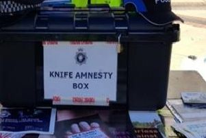 A knife amnesty box that was placed on Corporation Street in Corby
