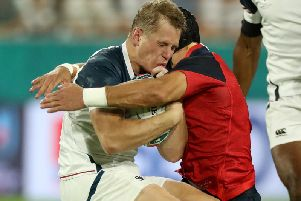Piers Francis put in a hit on Will Hooley during the opening seven seconds of the game between England and the USA