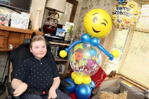 Sammy Lane with his balloon surprise from Time 2 Celebrate
