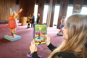 Visitors can use an iPad or mobile phone to unlock the audio and visuals