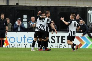 The Corby Town players celebrate Steve Diggin's goal during Saturday's 2-0 success over Biggleswade. Picture by Alison Bagley