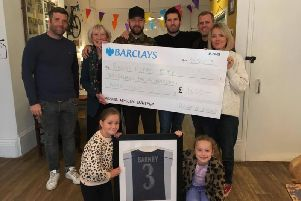The cheque is handed over to Johnny's Happy Place.