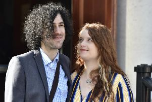 Emma DeSouza pictured with her husband Jake outside the Royal Courts of Justice in Belfast.