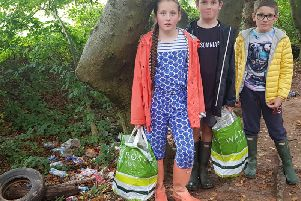 Three Kenilworth school children who picked up rubbish over the weekend with their mother Claire Woodside at the Glasshouse Spinney wood