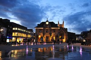 Peterborough's Cathedral Square at dusk with the fountains lit up. Photo: David Lowndes/Peterborough Telegraph
