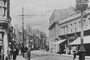 This picture shows a relatively bustling Westgate with the Bull Hotel on the right.This  was taken in 1920s and you can make out the tram tracks in the road.