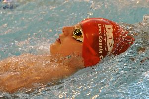 Zack Treharne won three golds at the Fenland Open Meet, swimming three county qualifying times.