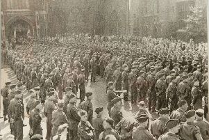 A large gathering of troops by the west front of the cathedral to celebrate victory in Europe