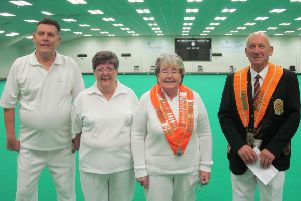 Leading officials of the Northants Bowling Federation and Northants Women's Bowling Federation line-up before Sunday's annual men against ladies indoor match at Peterborough & District.  Left to right are Dick Noble (NBF deputy president), Liz Barr (NWBF secretary), Jessica Phillips (NWBF president) and Tony Mace (NBF president).