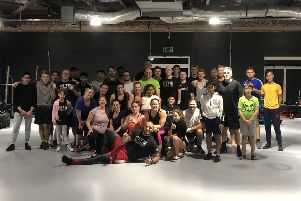 Karl Wheeler (front) with members of his new gym F.I.T. Studio.