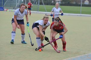 City of Peterborough Ladies in action (red).
