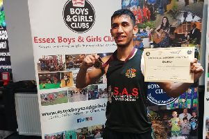 Fazan Khalid with his championship certficiate.