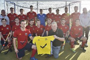 City of Peterborough skipper Ross Booth accepts a new away strip from sponsore Neil McCulloch of insurewise. Photo: David Lowndes.