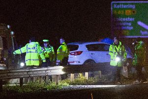 Police at the scene of the crash this evening. Photo: Terry Harris