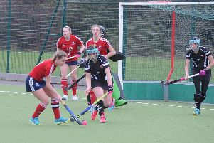Action from City of Peterborough Ladies seconds (red) and Bourne Deeping firsts. Photo: David Lowndes.