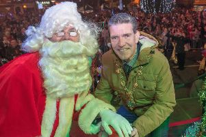 The Mayor Councillor John Boyle helps Santa to switch on the Chrismas lights in Strabane on Saturday.