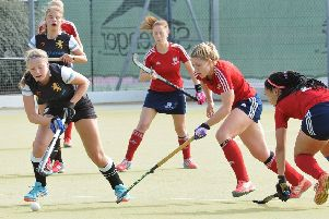 Anna Faux (red, centre) played well for City of Peterborough against Canterbury.