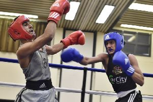 Ali Hassan (right) in action against Abdul Samad.