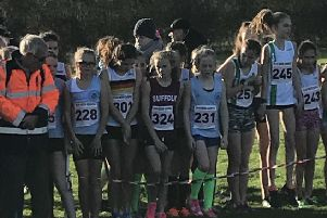 Eliza Maldon (231) and Matilda Halford (228) at the start of the  Under 13 girls race.