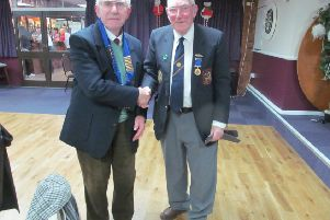 New Peterborough League president Gordon Stirman (left) received the chain of office from outgoing president Dick Gill.