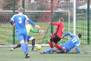 Action from Netherton United's Peterborough Senior Cup defeat at the hands of Whittlesey Athletic (blue) last weekend.