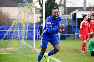 Avelino Vieira wheels away in delight after opening the scoring for Peterborough Sports against Coleshill. Photo: James Richardson.