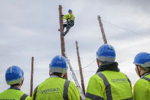 Trainee engineers at work in one of the fields of poles at the Peterborough training school.