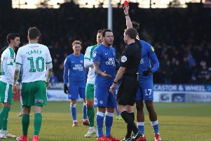 Posh playmaker Lee Tomlin is sent off against Plymouth by referee Peter Wright. Photo: Joe Dent/theposh.com.