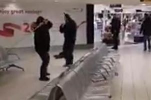 An image taken from the video footage of the fight between a group of men in Belfast International Airport on Saturday.