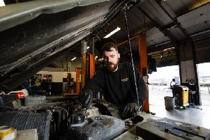 Adam Smith, Halfords Autocentre Manager and former soldier, services an army Land Rover as the retailer announces that it will be signing the Government's Armed Forces Covenant, at Halfords Autocentre in Peterborough.  Picture: Jeff Spicer/PA Wire