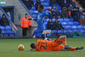 Posh winger Siriki Dembele picked up an injury in this incident in the game against Plymouth. Photo: Joe Dent/theposh.com.