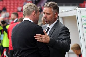 Darren Ferguson (right) and Grant McCann are in direct opposition at the Keepmoat Stadium.