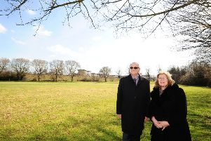 Peterborough City Council  leader Cllr  John Holdich and education cabinet member Cllr Lynne Ayres at the proposed site of the new campus at the Embankment