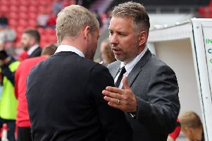 Darren Ferguson (right) shakes hands with Grant McCann ahead of Doncaster v Posh last season.