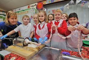 Pupils from Braybrook Primary Academy  taking part in the Kids Country breakfast week.  Pupils  making sausages with  Sandra Lauridsen, education manager for the East of England Agricultural Society EMN-190122-112210009